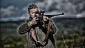Masculine Hobby Activity. Man Hunter Aiming Rifle Nature Background. Experience And Practice Lends S poster