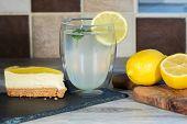 Lemon Cheesecake. Authentic Freshly Prepared Home-made Organic Lemonade. Summer Food. Cool Glass Of  poster