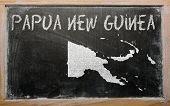 Outline Map Of Papua New Guinea On Blackboard