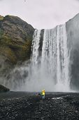 Beautiful Scenery Of The Majestic Skogafoss Waterfall In Countryside Of Iceland In Summer.  Girl Wit poster