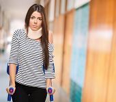 stock photo of crutch  - Portrait Of A Young Woman With Crutches - JPG