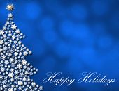 picture of happy holidays  - Happy Holidays script on blue glowing winter background - JPG