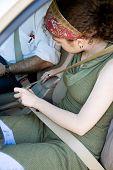 GIrl Fastens Seatbelt