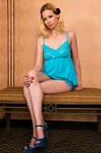 picture of nighties  - Pretty blonde woman in a blue nightie - JPG