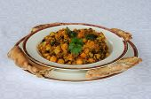 Vegetarian balti with Naan bread.
