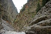 stock photo of samaria  - Tourist route in Samaria Gorge on Crete Island Greece - JPG