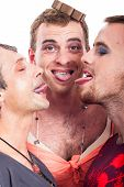foto of transvestites  - Close up of funny transvestites sticking out tongue isolated on white background - JPG