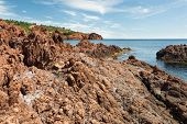 stock photo of porphyry  - Volcanic rocks Esterel Massif overlooking the Mediterranean Sea - JPG