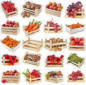 Fresh tasty fruits, vegetables, berries, nuts in a wooden crate box ,collection set  isolated on a w