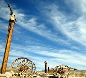 stock photo of trailblazer  - The blue sky and broken vehicle all that remains from trailblazers of the wild West in the Valley of death Nevada - JPG