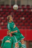 VIENNA,  AUSTRIA - SEPTEMBER 20 Mario Sonnleitner (#6 Rapid) heads the ball during the Europa League