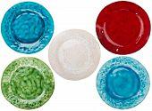 image of raku  - Set of handmade pottery plates isolated on white background - JPG