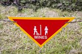 image of landmines  - Land mine or minefield danger warning sign in a war zone area - JPG