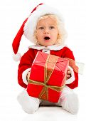 Young female Santa with a Christmas gift  - isolated over white