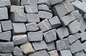 pic of porphyry  - Detail of rough granite cubes for building - JPG
