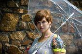Young Pregnant Woman Under Umbrella Waiting