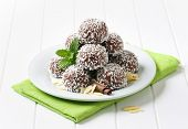 stock photo of sprinkling  - belgian pralines sprinkled with coconut - JPG