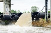 pic of greenpeace  - large water pipe pumps flood water and drains - JPG