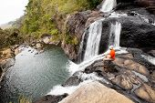 Trekker Looks At Wild Waterfall In Horton Plains National Park, Sri Lanka