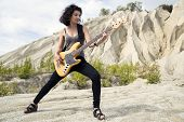 Woman On Sandy Background With Bass Guitar
