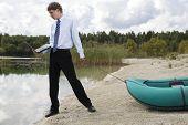 Dressed Man Plan Drags Boat At Lake