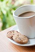 Coffee Cup With Cookie .