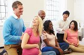 stock photo of natal  - Couples Attending Ante Natal Class Together - JPG
