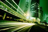 stock photo of speeding car  - Fast moving cars at night of city - JPG