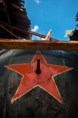 stock photo of communist symbol  - Soviet symbol on a metal background with blue sky - JPG
