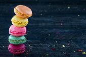 Colorful Macaroons On A Dark Black Wooden Background