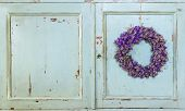 Lavender Flower Wreath Hanging On An Old Door