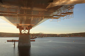 foto of flatboat  - Bridge support in sunset
