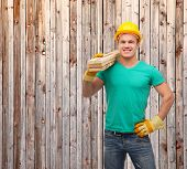repair, construction and maintenance concept - smiling male manual worker in protective helmet carry