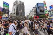 Crowds Of People At Shibuya Crossing In Tokyo, Japan.
