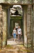 Beautiful young couple at passageway of Preah Khan temple  in Angkor Wat, near Siem Reap, Cambodia.