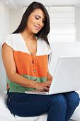 Young casual woman relaxed working from home