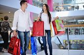 stock photo of elevator  - happy young couple with bags in shopping centre mall - JPG