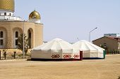 picture of yurt  - Mosque in the city of Aktau stand near the yurt - JPG