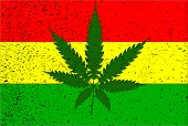 stock photo of reggae  - Rastafarian flag with hemp leaf motif and a mild grunge FX - JPG
