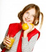 Little girl with oranges and juice. Isolated on white.