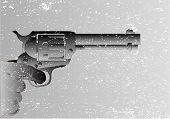 stock photo of dead-line  - A hand with the finger pulling the trigger of a six gun - JPG