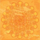 image of symmetrical  - Abstract circle lace pattern on orange grunge background  - JPG