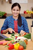 Young Indian Woman Cutting Vegetables