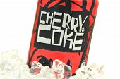Can of Cherry Coke drink on ice.