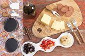 Savory Snacks On A Rustic Table With Red Wine