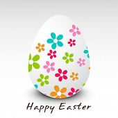 Happy Easter celebration card with easter egg decorated by colorful flowers on grey background.