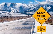 stock photo of slippery-roads  - Motorists are warned of dangerous driving conditions on a road leading into the Sierra Nevada Mountains - JPG
