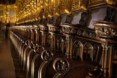 Church Pews. Detail wood carving.6 cathedral Barcelona