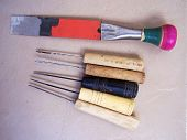 close up of cobbler's tool kit on an isolated background