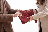 foto of yanks  - A man taking a bag from a woman - JPG